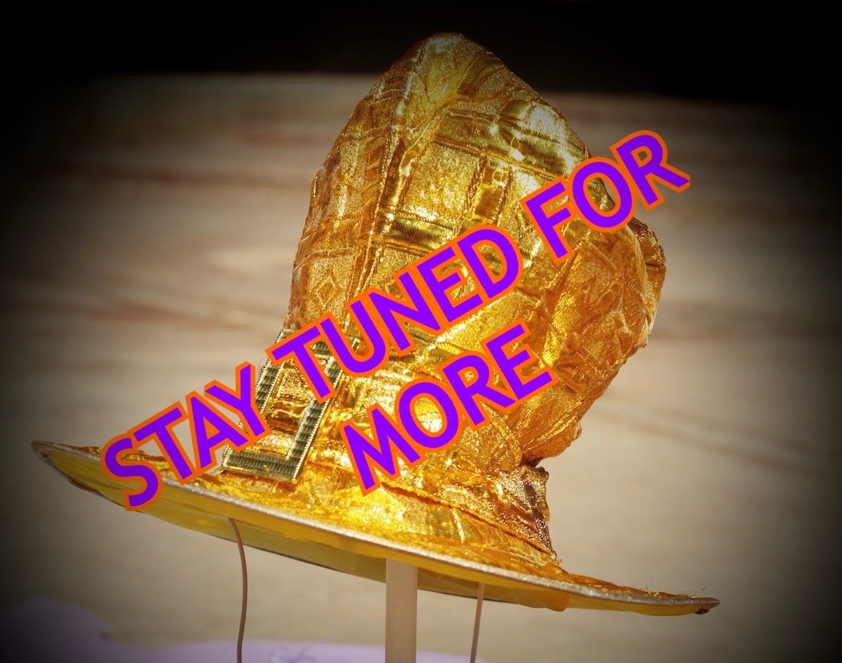 Gold narrator magic hat with text Stay Tuned for more
